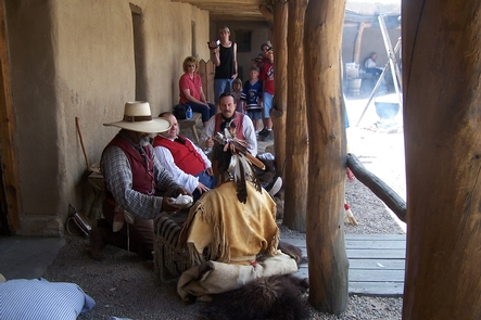 A Lakota warrior barters with the traders in the fort plazaTrade with a Lakota warrior for trade goods from around the world.
