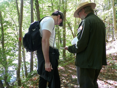 Bluestone Turnpike TrailNPS Ranger Richard Altaire provides an overview of the park map to a visitor to the Bluestone NSR.
