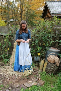 Millbrook DaysA woman braids rye straw for hatmaking