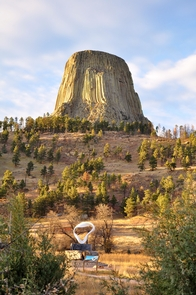 Devils Tower overlooking the Circle of Sacred Smoke Sculpture