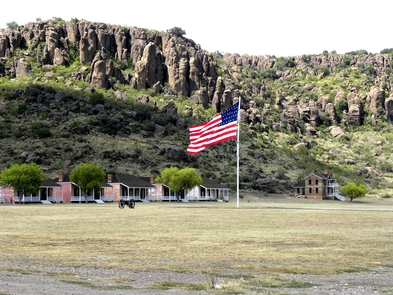 Parade GroundGarrison flag flying over the post within the box canyon Fort Davis is located.