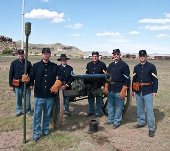 Artillery CrewThe Artillery Crew stand ready for orders to post at their positions and fire the U.S. 3-inch Ordnance Rifle.