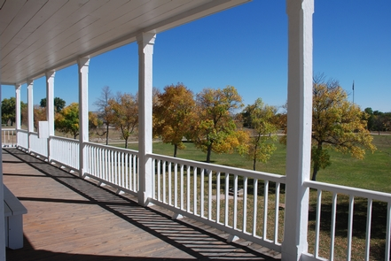 """Parade Ground from the Porch of """"Old Bedlam""""A fall view of the parade ground from """"Old Bedlam"""" the oldest surviving structure at Fort Laramie and in the state of Wyoming, constructed in 1849."""