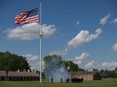 Flag RetreatVolunteers help recreate the U.S. Army flag lowering ceremony known as Retreat.