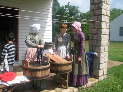 Laundry DayHigh school students dressed as laundresses demonstrate laundry methods of the 1840s