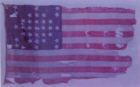 """Fort Sumter Storm FlagThe 33-star """"storm"""" flag was flown over Fort Sumter during the April 12-13, 1861 bombardment of Fort Sumter. The larger garrison flag had been lowered to repair a tear on April 11. On display at the Fort Sumter Museum."""