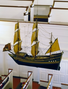 """Model of a ship hanging inside Gloria Dei ChurchHanging from the ceiling of Gloria Dei are models of the two ships that brought the first Swedish colonists to North America in 1638, the """"Kalmar Nyckel"""" and the """"Fogel Gryp."""""""