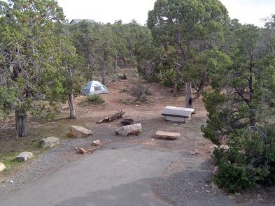 Empty campsiteEach campsite has a picnic table and a fire ring with a cooking grill