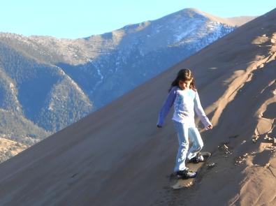 Girl SandboardingRent a specially designed sandboard or sand sled. Note: cardboard, snow sleds, saucers, etc. don't slide on dry sand.