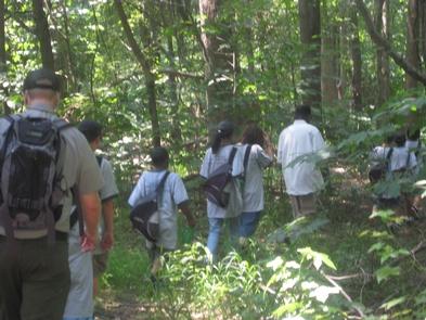 Park Ranger on a trail walkChildren enjoy the outdoors with a Park Ranger on a trail walk in Greenbelt Park