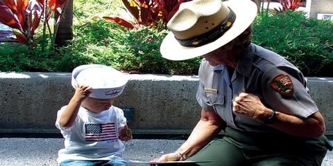 Park RangerA Park Ranger helping a young visitor