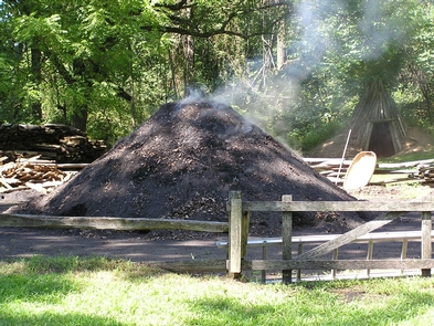 """Charcoal PileCharcoal was the fuel used to fire Hopewell Furnace and other furnaces of its age.  Thousands of bushles of charcoal were made from hardwood trees on the furnace lands and entered into the furnace to keep it """"in blast."""""""