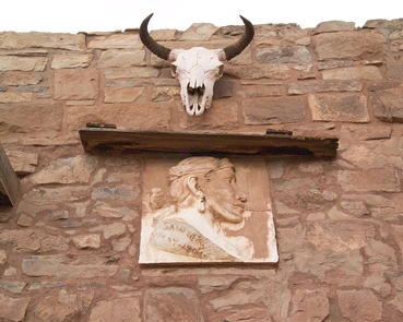 Front of Trading PostAbove the entry way into the trading post, there is a sun-bleached steer skull.