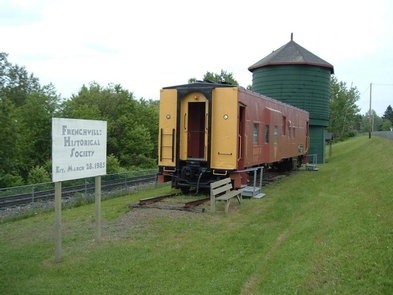 Bangor/Aroostook Caboose & Green Water TankThis site preserves one of a few surviving train water tanks in the United States and a 1940s era caboose