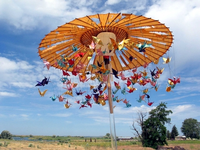 Origami Go AroundOrigami cranes twirl on a colorful carousel.