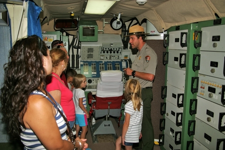 Park Ranger leads a tour in the underground control centerA park ranger leads a tour in the underground control center