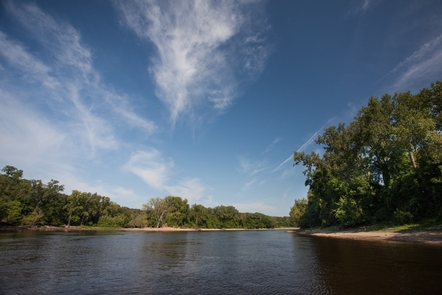 """Clouds Over the Mississippi RiverThe upper stretch of the Mississippi River in the Mississippi National River and Recreation Area is often referred to as the """"Prairie River"""" due to its gentle banks. Further downstream is the Mississippi River gorge and below that is the floodplain river"""