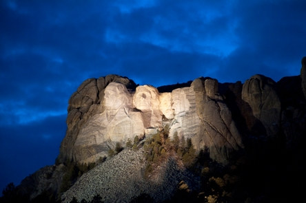 Mount Rushmore At NightMount Rushmore illuminated under a darkening evening sky.