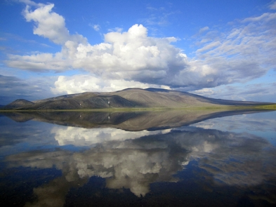 Mirror ImageThe Delong Mountains are flawlessly reflected in the clear, clean water of Desperation Lake in the northern part of Noatak National Preserve.