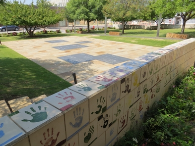 Children's AreaThis area provides letter shaped chalkboards to allow the continued emotional expressions from those young and old. A surrounding wall displays a collection of painted tiles sent by schools, showing their compassion for the bombing-affected community