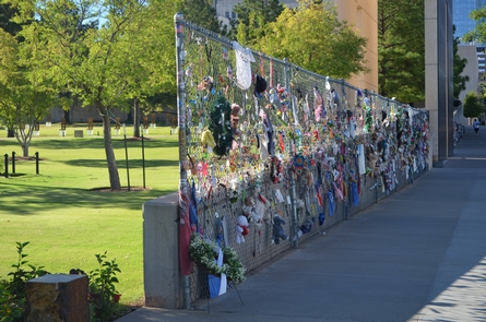 Memorial FenceThis 200 foot section of chain link fence was taken from the original barrier surrounding the bombing site. The fence served as the first spontaneous memorial and a location for people to leave tokens of collective grief. It retains this purpose still to
