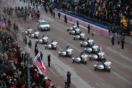 Pennsylvania AvenuePolice motorcycles pass in formation during the 2013 inaugural parade.
