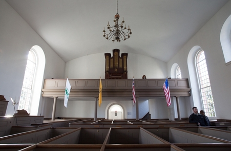 The restored church pewsThe pews have been rebuilt to resemble what was here when the stone church was first opened.