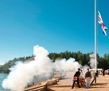 EncampmentReenactors fire a cannon at Encampment
