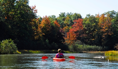 A fall paddle down the riverA quiet paddle through fall splendor.
