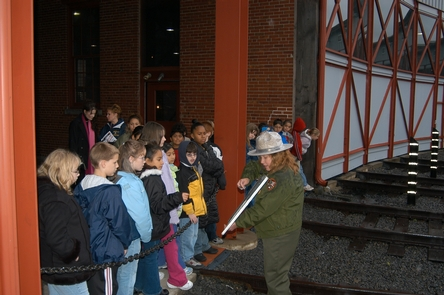 Education ProgramsRanger-led educational programs are available at Steamtown NHS.  Here, a park ranger works with a group of students to explain Roundhouse architecture