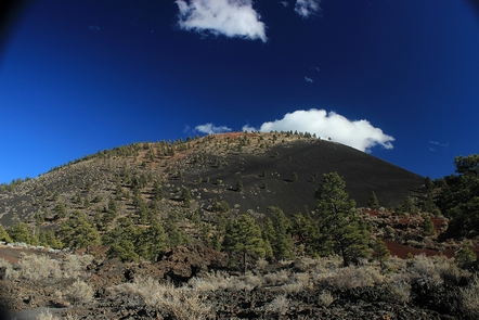 Sunset Crater VolcanoSunset Crater Volcano is named for the color of the rusty red cinders near its peak.