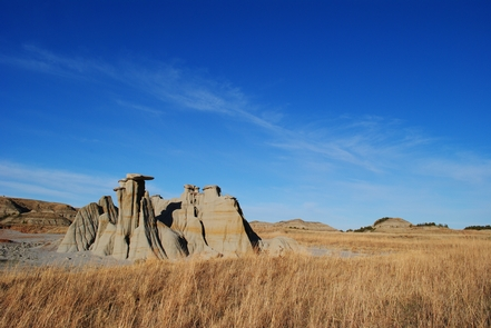 """HoodoosTheodore Roosevelt described the badlands as """"so fantastically broken in form and so bizarre in color as to seem hardly properly to belong to this earth."""""""