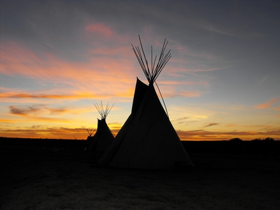 Tipis at SunsetCheyenne tipis backlite by sunset