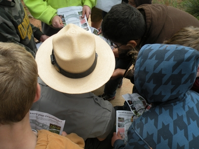 Learning Something New at WashitaA Park Ranger helps children with their Jr. Ranger books.