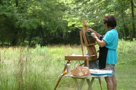Artist painting at Weir Farm National Historic SiteA plein air artist captures the beauty of the landscape at Weir Farm National Historic Site