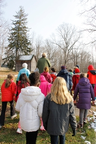 Park Ranger and students walking to the pondPark Ranger Andrew Lowe leads a group of students on a trip to Weir Pond.
