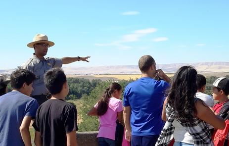 WHMI Monument HillRanger Lenihan describes the mission site to school field trip participants.
