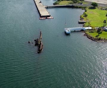 The USS UtahThe USS Utah lays where she fell on the north side of Ford Island. This decision was made in 1944 after several attempts at raising the ship failed. The quiet decision was made to leave the bodies of 58 crewmen onboard, considering them buried at sea.