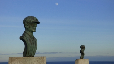 Busts and MoonCopper busts of Wilbur and Orville Wright stand atop Big Kill Devil Hill.