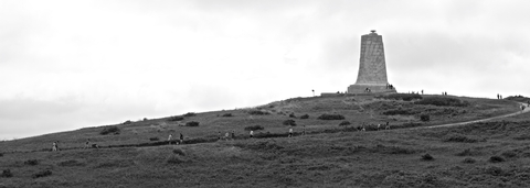 Journey to the TopVisitors climb Big Kill Devil Hill to visit the Wright Brothers Monument.