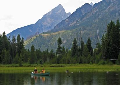 String Lake CanoesCanoeing on String Lake is a popular way to enjoy the scenery.