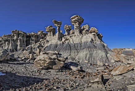 Devil's PlaygroundEroded towers called hoodoos loom above Devil's Playground.