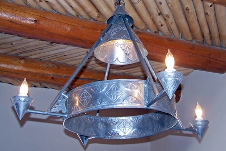 Painted Desert Inn Punched Tin Light FixturThe handmade Spanish-colonial-style punched tin light fixtures were made by the CCC in the 1930s for the Painted Desert Inn NHL.