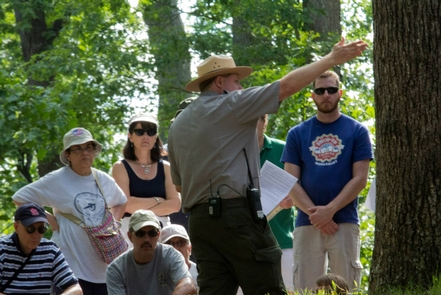 Ranger leading a tour at Cold HarborThe park offers tours during the summer and throughout the year.
