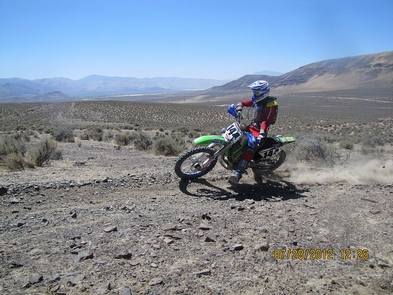 Dry Valley OHV AreaNick Alosi, MRANN Lassen MC President riding at the Dry Valley OHV Area doing a wheelie.