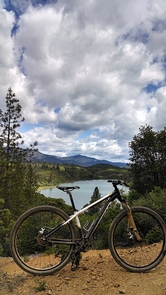 Mountain bike on the keswick eastside trailsPhoto of a mountain bike on the Keswick Eastside Trails, with Keswick Reservoir in the background.
