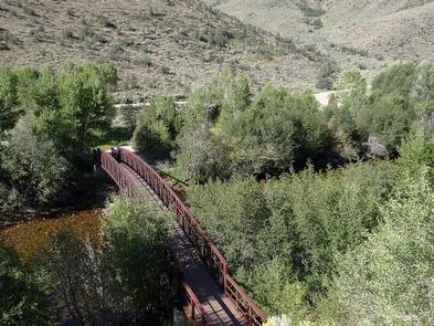Encampment River CampgroundA bridge spans the Encampment River.