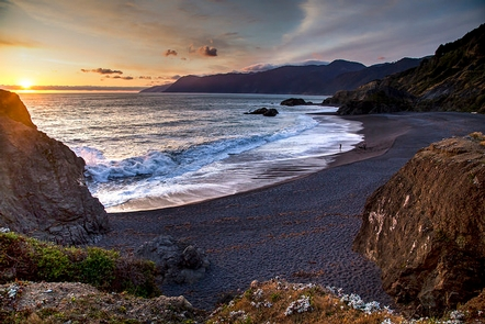 Little Black Sands Beach at King Range National Conservation AreaThe sun sets over the Pacific Ocean at the Little Black Sands Beach.