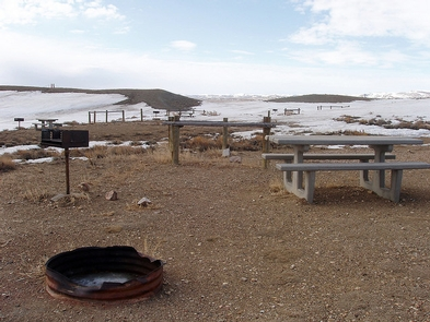 Teton Reservoir Recreation SiteA view of a picnic table, fire ring and grill.