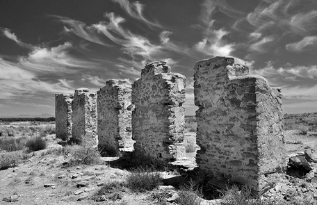 Fort Craig Historic SiteFive standing walls of Fort Craig photographed from a low angle in black and white.
